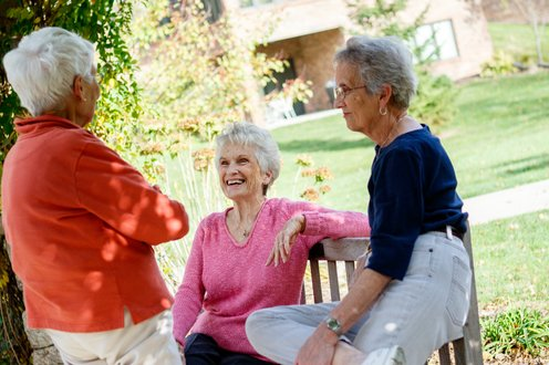 Picture of 3 ladies chatting happily on a bench