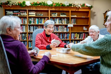 Group of senior women playing cards